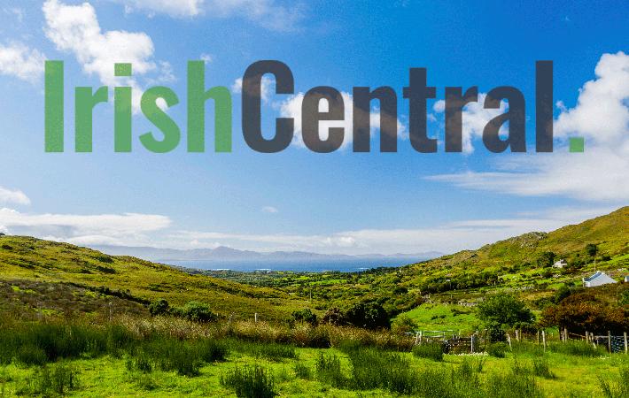 Irish road sign including names as Gaeilge.
