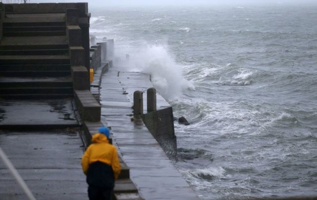 Waves crash against Dun Laoghaire Harbour, in Dublin, as Storm Lorenzo passes.