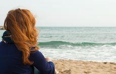 Thumb_red_head_beach_girl_woman_istock