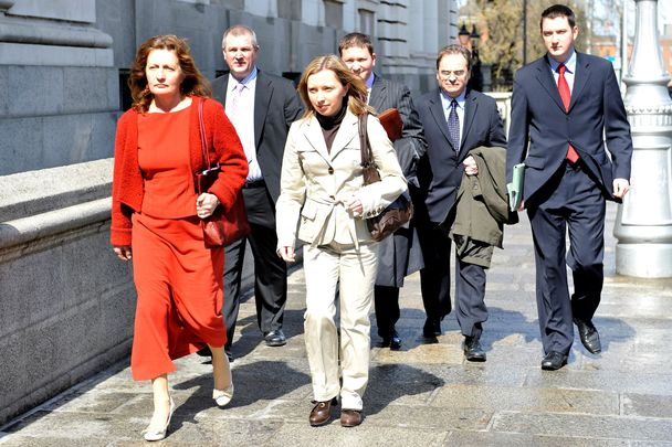 April 24, 2008: (L-R) Widow of murdered solicitor Pat Finucane, Geraldine, brother of Pat Finucane, Dermot, daughter Katherine (front) son Michael (back) their solicitor Peter Madden who founded his solicitors firm with Pat in 1979 and son John, pictured outside Government Buildings on their way into talks with the Government.