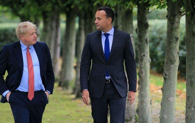 British Prime Minister Boris Johnson (L) walks with Ireland\'s Taoiseach Leo Varadkar (R) in the grounds of Thornton Manor Hotel near Birkenhead on October 10, 2019, in Liverpool, England.