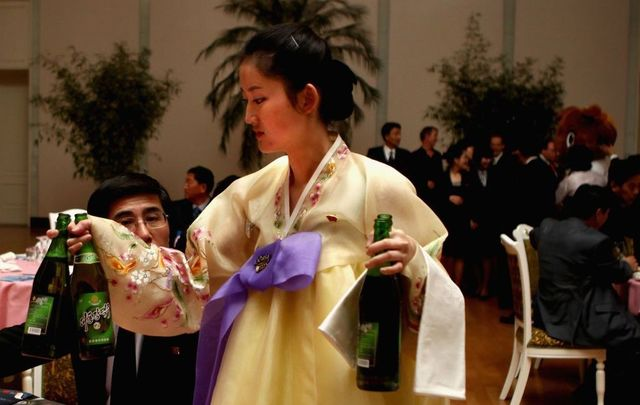 North Korean waitresses distribute beer during an official reception on April 2, 2011, in Pyongyang, North Korea. Pyongyang is the capital city of North Korea and the population is about 2,500,000.