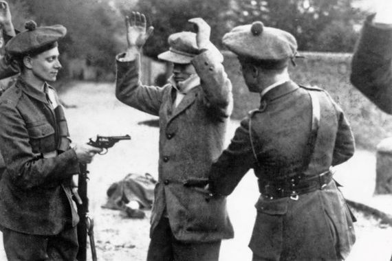 Members of the Black and Tans search an Irish citizen during the War of Independence.