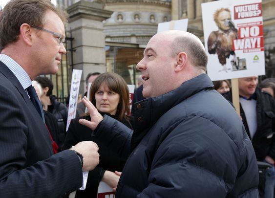 David Hall of the Irish Mortgage Holders Organisation (right) speaking to Labour Party\'s Arthur Spring, outside Ireland\'s government buildings during a 2014 protest over vulture funds.