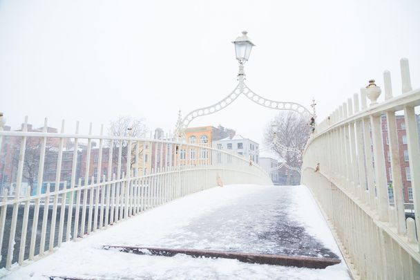 The Ha\'penny bridge covered in snow and ice in Dublin City, Ireland. \n