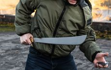 Thumb machete crime weapon getty