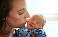 Thumb baby boy mother kiss getty