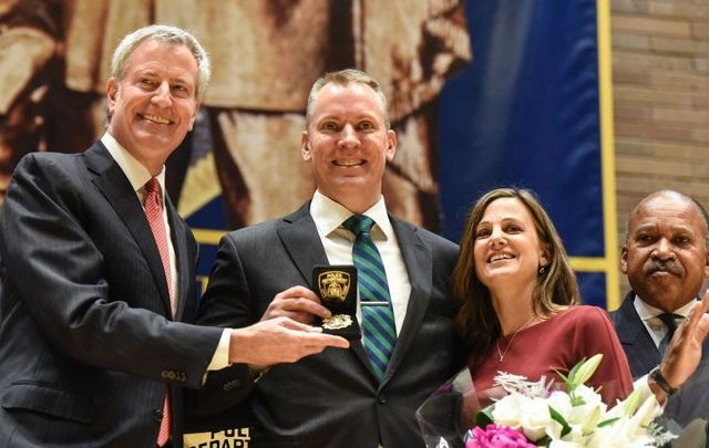 Dermot Shea (C) poses after being sworn in as the new NYPD Police Commissioner while standing next to the Bill de Blasio, Mayor of New York City, (L) on December 2, 2019, in New York City. Dermot Shea is the 44th commissioner of New York City following a three-year term of James P. O\'Neill.