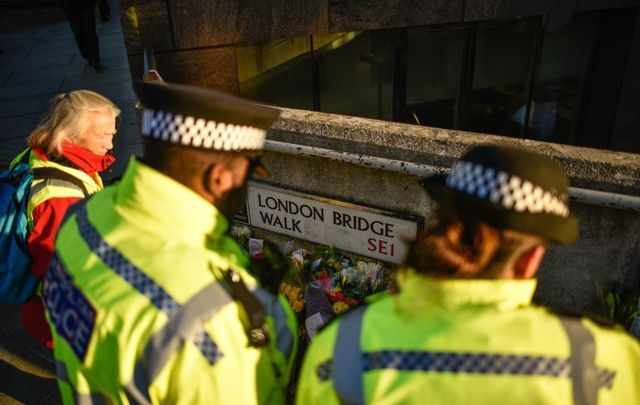 Floral tributes are left for Jack Merritt and Saskia Jones, who were killed in a terror attack, on December 2, 2019, in London, England.