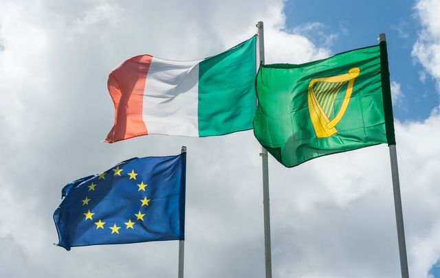 Irish and European flags blowing in the wind.