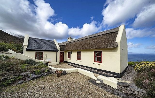 Just over 20 years old, this cottage in Co Kerry still has a traditional thatched roof.