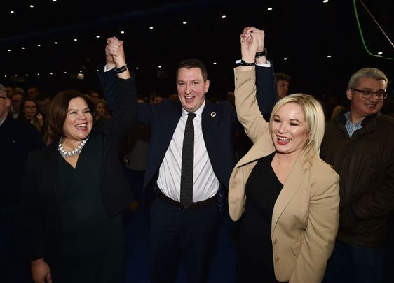 Sinn Féin candidate John Finucane celebrates his victory over DUP candidate Nigel Dodds alongside Sinn Fein President Mary Lou McDonald and Sinn Fein northern leader Michelle ONeill in the Belfast count center at the Titanic Exhibition center on December 13, 2019, in Belfast, United Kingdom.