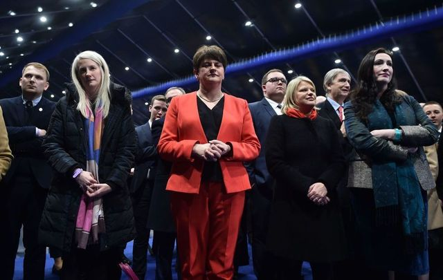 DUP leader Arlene Foster watches on as Sinn Fein candidate John Finucane is declared the winner of the north Belfast seat over DUP candidate Nigel Dodds in the Belfast count center at the Titanic Exhibition center on December 13, 2019, in Belfast, United Kingdom.