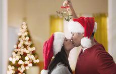Thumb mistletoe christmas kissing kiss getty
