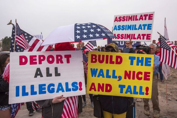 upporters of U.S. President Donald Trump rally for the president during his visit to see the controversial border wall prototypes on March 13, 2018, in San Diego, California.