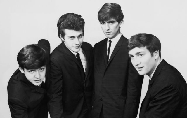 The Beatles: Paul McCartney, Pete Best, George Harrison and John Lennon.