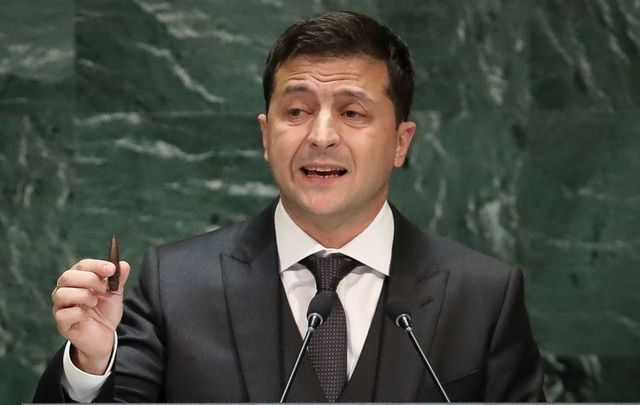 President of Ukraine Volodymyr Zelensky holds up a bullet as he addresses the United Nations General Assembly at UN headquarters on September 25, 2019, in New York City.