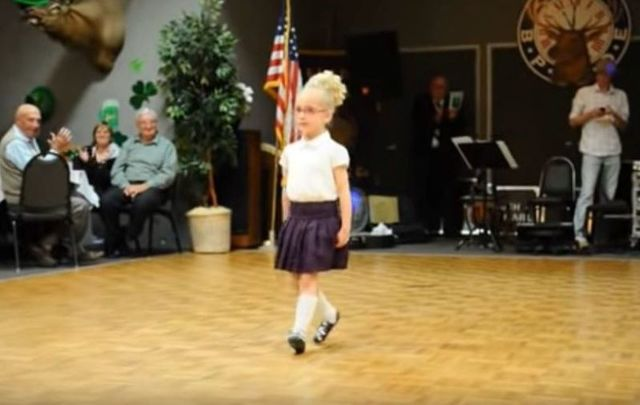 """4-year-old \""""McCutie Tiny Irish Dancer\"""" wows the crowd during a St. Patrick\'s Day performance."""