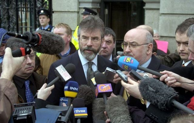 Feb 10, 2005: Sinn Fein President Gerry Adams (L) and TD Caoimhghin O Caolain, speaking to the media outside Leinster House, Dublin in response to the report from the Independent Monitoring Commission, and its main conclusion that the IRA was responsible for the Northern Bank raid.