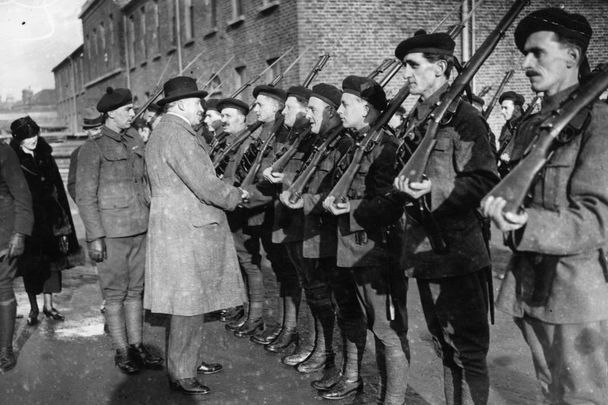 Sir Hamar Greenwood inspects a group of Black and Tans in 1921.