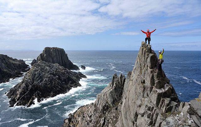 Rock-climbers at Malin Head, Donegal, along the Wild Atlantic Way.