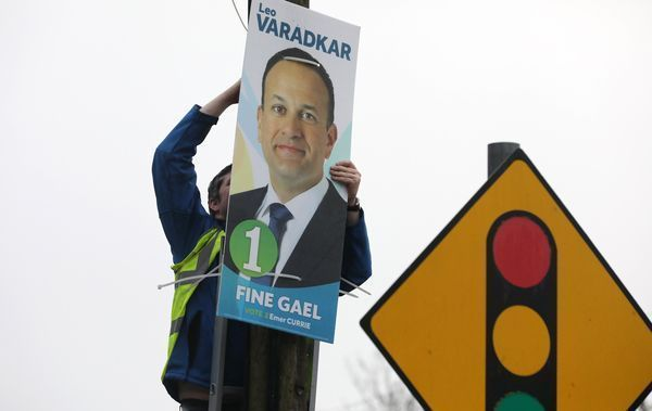 Putting up Taoiseach and Fine Gael leader Leo Varadkar posters in his constituency in Dublin on the day he announces he is to seek dissolution of the 32nd Dáil for a general election.