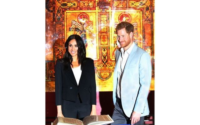 Megan Markle and Prince Harry during their visit to the Book of Kells, at Trinity College in Dublin.