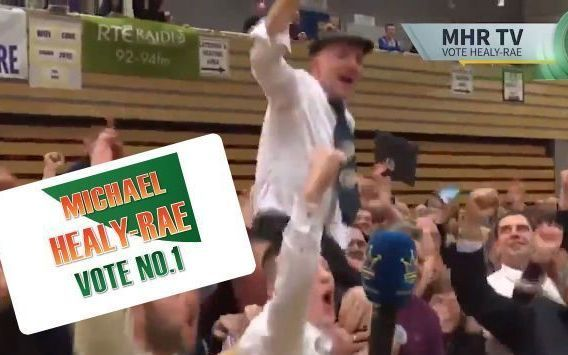 Independent Co Kerry politician Michael Healy-Rae held aloft by fans.