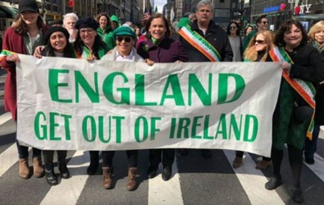 Mary Lou McDonald poses behind a United Ireland banner at the 2019 St Patrick\'s Day parade in New York.