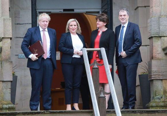 British Prime Minister Michelle O\'Neill, Sinn Fein leader Michelle O\'Neill, Democratic Unionist Party leader Arlene Foster and the UK Northern Ireland Secretary Julian Smith.