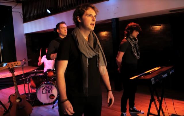 Stiofan Ó\'Fearail, front, sings with Seo Linn band members