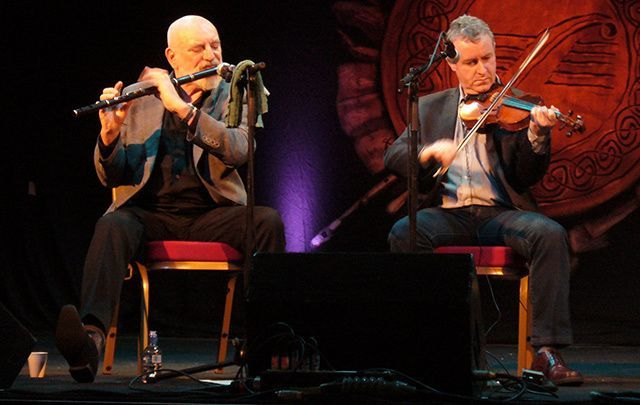 Two members of the Chieftains during a performance.
