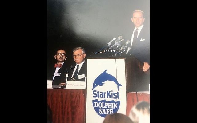 Then-Senator Joe Biden speaking at a press conference in support of dolphin-safe legislation in 1990, with Ted Smyth pictured far left.