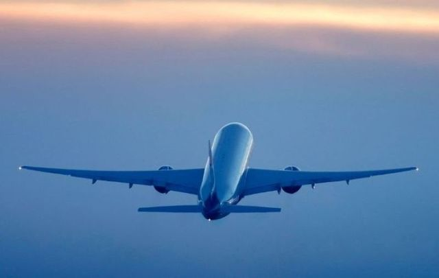A total of 13 passengers on the flight tested positive for the coronavirus.