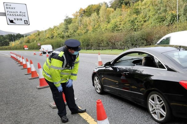 October 7, 2020: Gardai speaking to commuters at a checkpoint on the M11 near Bray as part of Operation Fanacht.