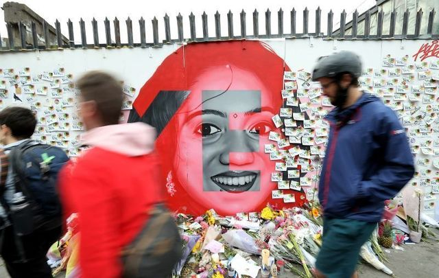 May 26, 2018: The mural of Savita Halappanavar by artist Aches on a white wall on Richmond Street South in Dublin city, on the eve of the Eighth Amendment referendum. As people began voting from early on Friday morning, flowers were left at the bottom of the mural, along with 'Yes' leaflets, pens, and sellotape so that people could leave notes.