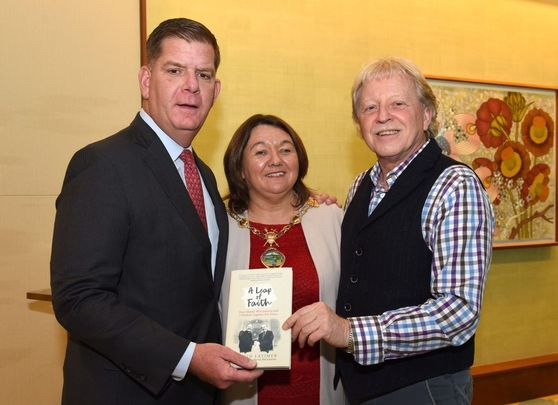 Golden years: At the 2019 Golden Bridges Conference in Boston, Mayor Marty Walsh (left) was presented with a copy of A Leap of Faith by Presbyterian peacemaker Rev David Latimer and Derry and Strabane Mayor Michaela Boyle.