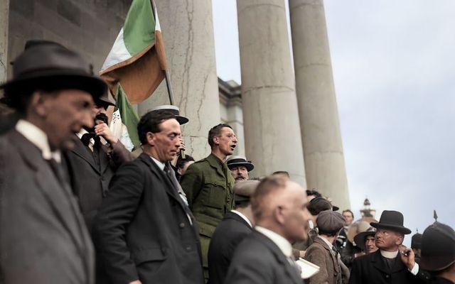 A colorized photograph of Éamon De Valera addressing a crowd in Ennis.