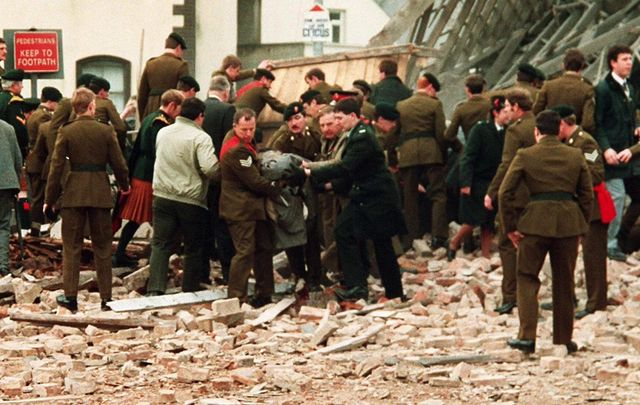 Members of the pubic and military deal with the aftermath of the 1987 Enniskillen, Remembrance Day, bombing which killed 11.