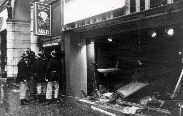 November 22, 1974: Firemen survey the damage outside the Birmingham pub \'Tavern in the Town\'