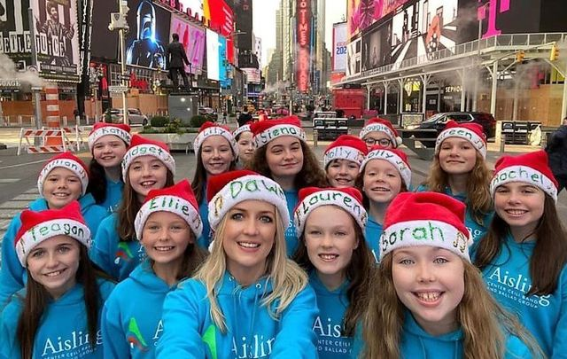 Irish music teacher Dawn Ní Dhochartaigh with her New York-based students in Times Square.