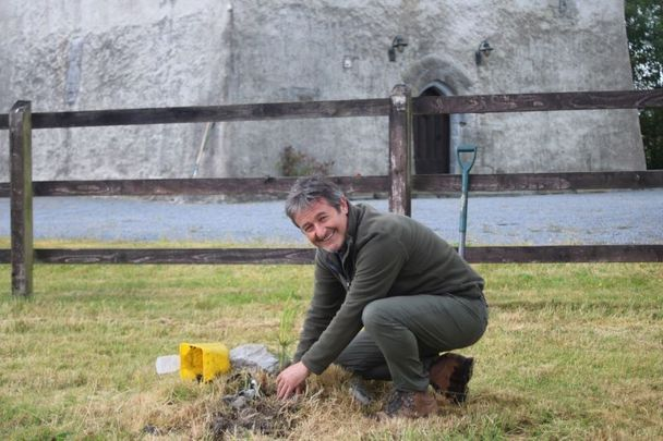 Naturalist and Filmmaker Colin Stafford Johnson plants an indigenous Scots Pine at Turin Castle Co Mayo