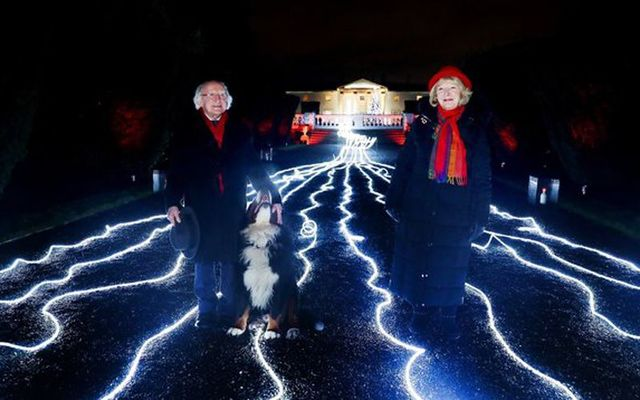 President Higgins and his wife Sabina on December 10 after the Christmas lights were turned on at the Áras An Uachtaráin. The river of light is meant to represent the light that always shines for the global Irish family.