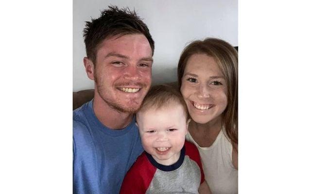 Sean Hughes, his wife Emily, and their son Sean.
