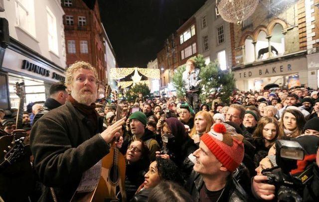 Glen Hansard at the Christmas Eve busk on Grafton Street in Dublin in 2016.