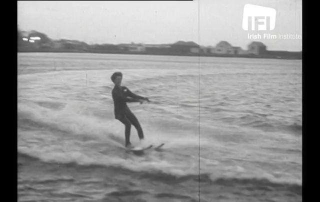Brr! Mrs. Carr braves the cold waters at Balscadden Bay on Christmas Day, 1961.
