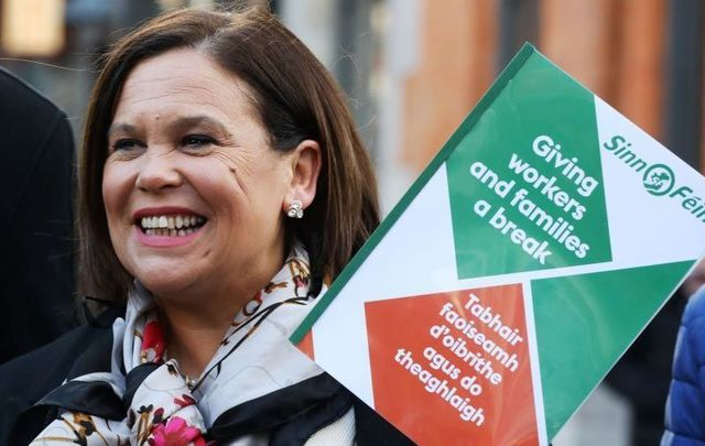 Mary Lou McDonald, the president of Sinn Féin, with the party\'s manifesto ahead of Ireland\'s General Election 2020.