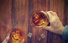 Thumb main whiskey hands man getty