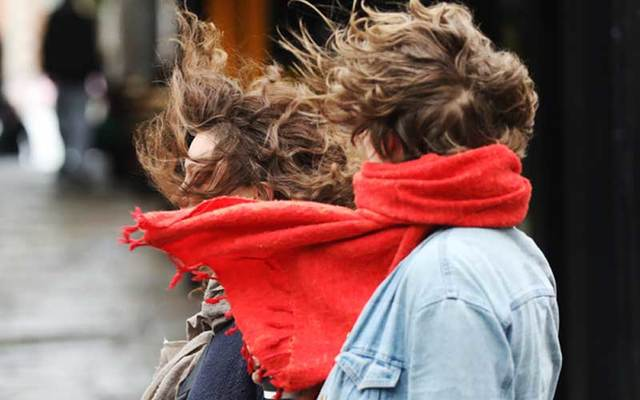 Members of the public experience strong gusts of wind from Storm Dennis, which hit Ireland this weekend.
