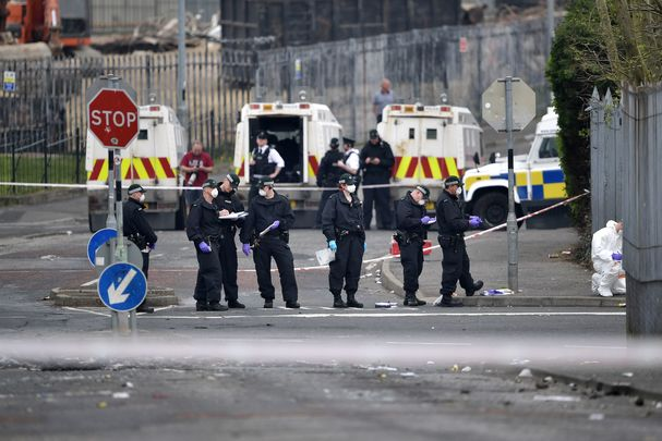 Police investigate the crime scene, Apr 2019, following the murder of Lyra McKee by the New IRA.